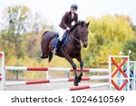 young rider girl on bay horse... | Shutterstock . vector #1024610569