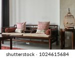 bird cage and wood couch | Shutterstock . vector #1024615684