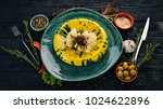 risotto with mushrooms. garnish.... | Shutterstock . vector #1024622896