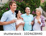 happy cheerful mature couples... | Shutterstock . vector #1024628440
