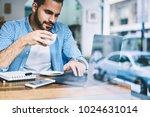pensive man reading news from... | Shutterstock . vector #1024631014