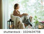 young woman sitting home in a... | Shutterstock . vector #1024634758