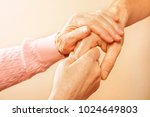 male doctor care giver holding... | Shutterstock . vector #1024649803