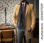 man in custom tailored suit and ... | Shutterstock . vector #1024657039