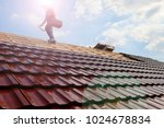 tiling a roof | Shutterstock . vector #1024678834