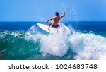 riding the waves. costa rica ... | Shutterstock . vector #1024683748