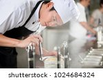 young asian chef plating food... | Shutterstock . vector #1024684324