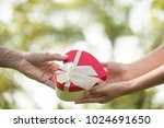 a red heart box present given... | Shutterstock . vector #1024691650
