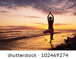 silhouette of a beautiful yoga... | Shutterstock . vector #102469274
