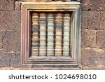 """Ancient Stone Window with Lathe-Turned Balusters, Banteay Srey, 10th-century temple dedicated to the Hindu god Shiva, known as a """"precious gem"""", or the """"jewel of Khmer art"""", Angkor Archaeological Park"""