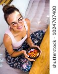 a beautiful woman has breakfast ...   Shutterstock . vector #1024707400