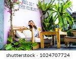 a beautiful woman has breakfast ...   Shutterstock . vector #1024707724