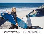 a surfer with a surfboard...   Shutterstock . vector #1024713478