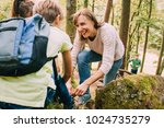happy family are hiking through ... | Shutterstock . vector #1024735279