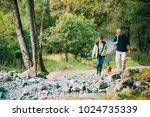 Stock photo senior couple are hiking through the lake district together with their pet dog 1024735339
