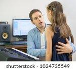 male vocal coach teaching...   Shutterstock . vector #1024735549