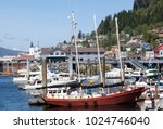different size boats docked in... | Shutterstock . vector #1024746040