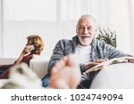 senior couple with smartphone... | Shutterstock . vector #1024749094
