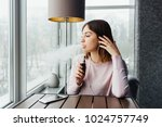 portrait of cute young vaping...   Shutterstock . vector #1024757749