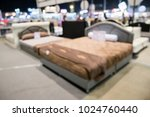 abstract blurred bed for sale... | Shutterstock . vector #1024760440