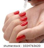 applying nail polish gloss on...   Shutterstock . vector #1024763620