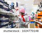 pretty girl in winter clothes... | Shutterstock . vector #1024770148