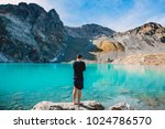 hiker man at the mountain lake. ... | Shutterstock . vector #1024786570