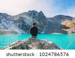 hiker looks at the mountain... | Shutterstock . vector #1024786576