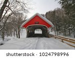 Red Covered Bridge In A Snowy...