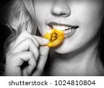 sexy blonde girl checks bitcoin ... | Shutterstock . vector #1024810804