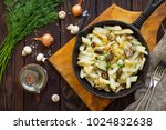 fried potatoes with champignons ...   Shutterstock . vector #1024832638