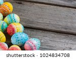 easter painted eggs on a wooden ... | Shutterstock . vector #1024834708