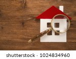 house with a magnifier on a... | Shutterstock . vector #1024834960
