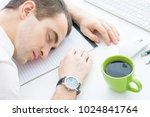 male fell asleep on the desktop ... | Shutterstock . vector #1024841764