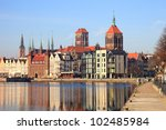 Motlawa river with city skyline in the background of Gdansk, Poland. - stock photo