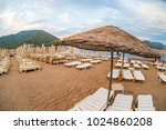 sun loungers on a beach in... | Shutterstock . vector #1024860208
