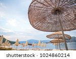 sun loungers on a beach in... | Shutterstock . vector #1024860214