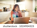 young african woman sitting at... | Shutterstock . vector #1024904323