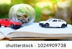 toy cars and money coins in... | Shutterstock . vector #1024909738