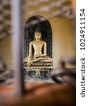 Small photo of 3-meter sculpture of Buddha which is behind bars in Kushinagar. The sculpture executed in blue stone is remarkable the fact her find has allowed to define Makhaparinirvana Buddha's place.