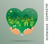 hand holding green heart with... | Shutterstock .eps vector #1024943749