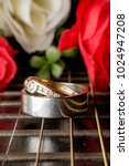 Small photo of ring and guitar, wedding rings, Engagement rings, wedding ceremony