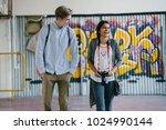 a young interracial couple... | Shutterstock . vector #1024990144
