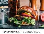 cheeseburger on a pretzel bun... | Shutterstock . vector #1025004178