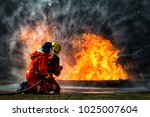 Small photo of firefighter training., fireman using water and extinguisher to fighting with fire flame in an emergency situation., under danger situation all firemen wearing fire fighter suit for safety.