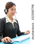 Beautiful asia young business woman with headset and computer isolate on white background - stock photo