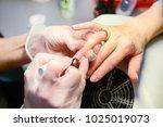 manicure in process | Shutterstock . vector #1025019073