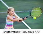 child playing tennis on outdoor ... | Shutterstock . vector #1025021770