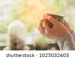 Woman Hands Holding Hot Cup Of...