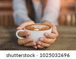 woman hands holding cup of hot... | Shutterstock . vector #1025032696